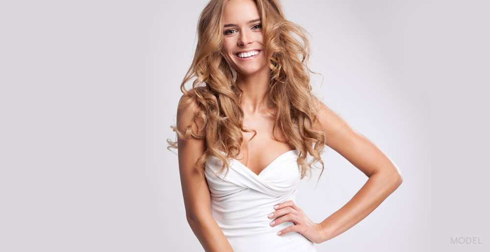 Joyful Caucasian Female Model with Long Curly Hair with White Backdrop