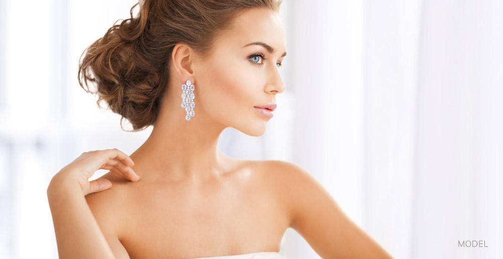 Woman with Clear Beautiful Skin Wearing Diamond Earrings