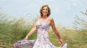Beautiful-female-in-a-dress-in-a-field
