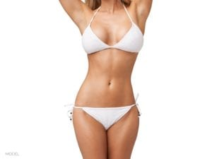 Portrait of female body in a white two piece bikini